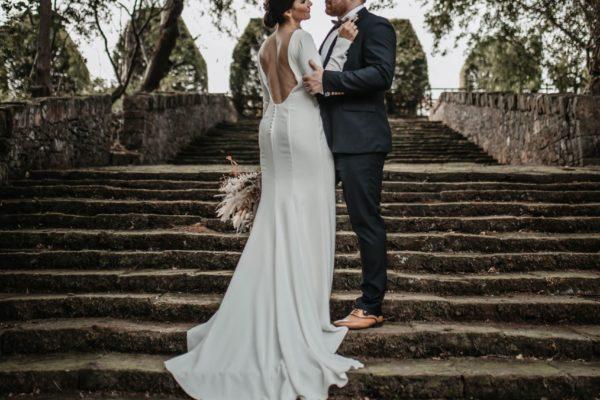 A bride and groom on the Italian Garden steps