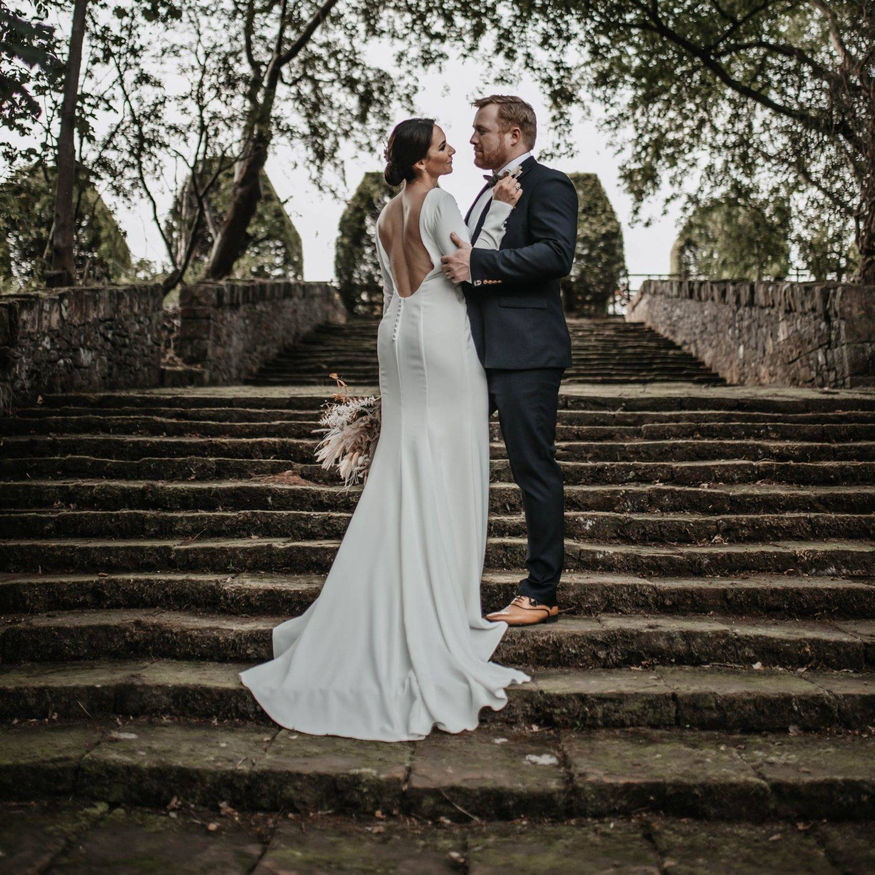 A bride and groom on the Italian Garden steps