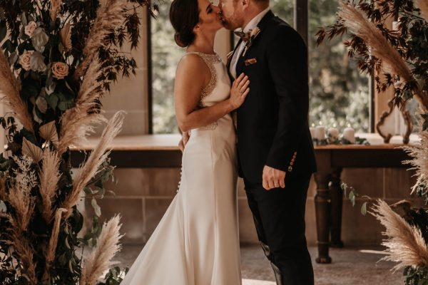 Newlyweds making their first kiss in The Orangery