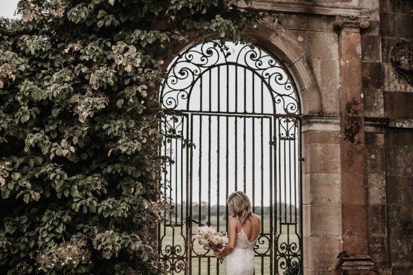A bride at the garden gate