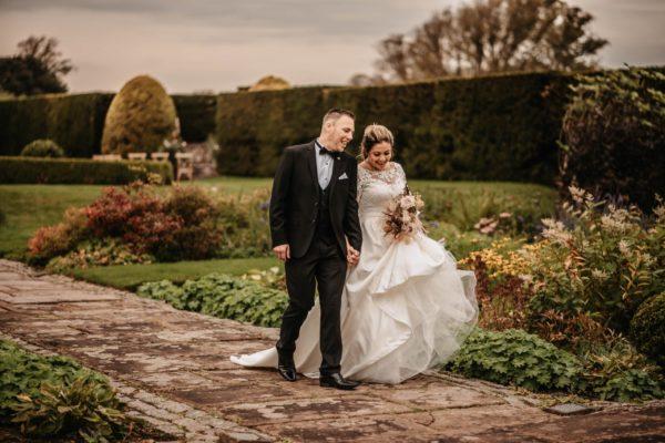 Newlyweds strolling through the Italian Gardens
