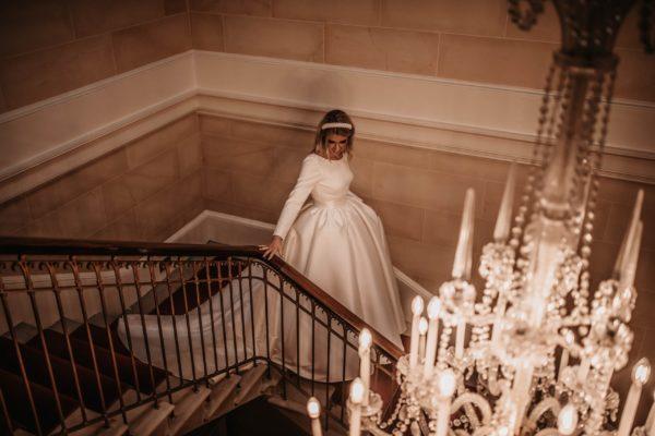 Bride walking down castle staircase