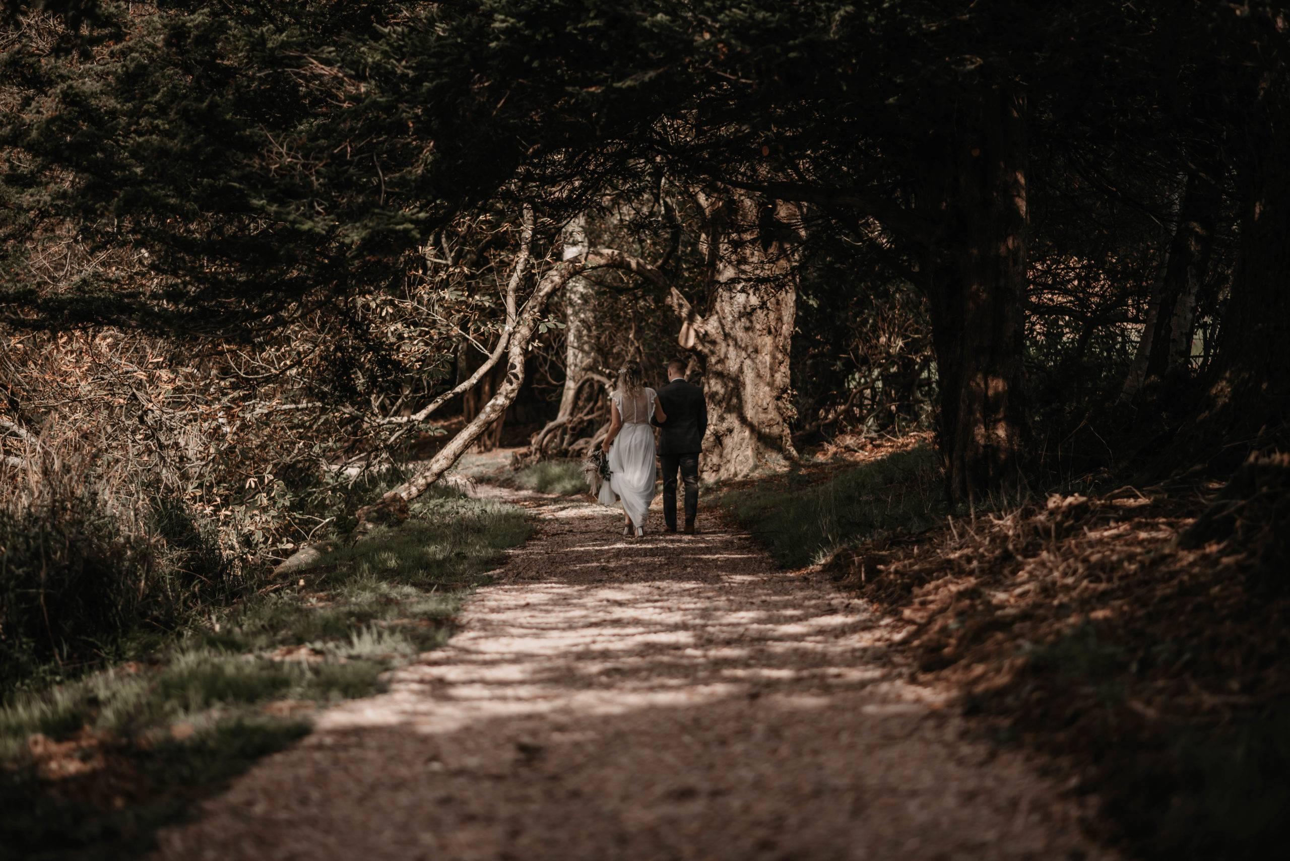 Couple strolling through woodland