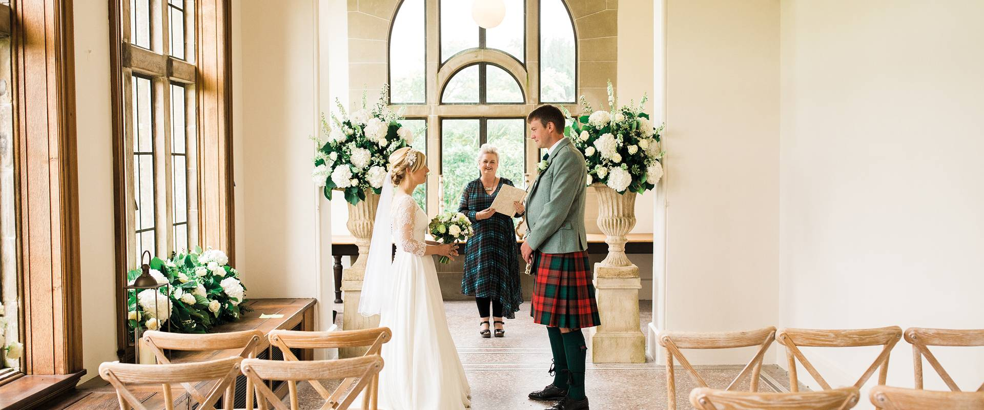 Couple getting married in The Ballroom at Kinmount House