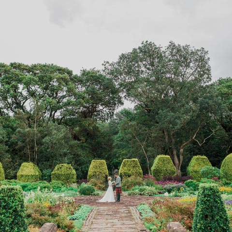 A bride and groom in the Italian Garden