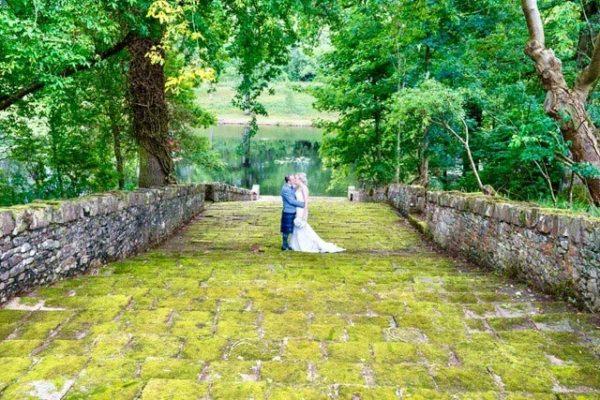 Newlyweds kissing on the Italian Garden steps