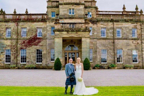 Newlyweds posing outside Kinmount Castle