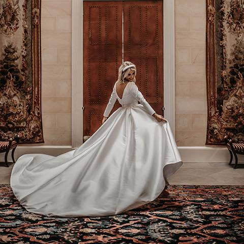 Bride showing off dress